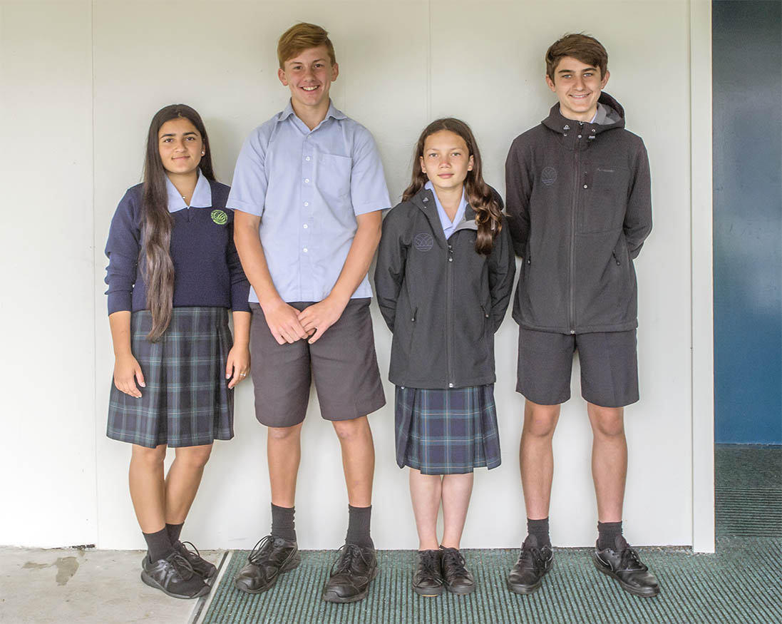 four students wearing GHS uniform