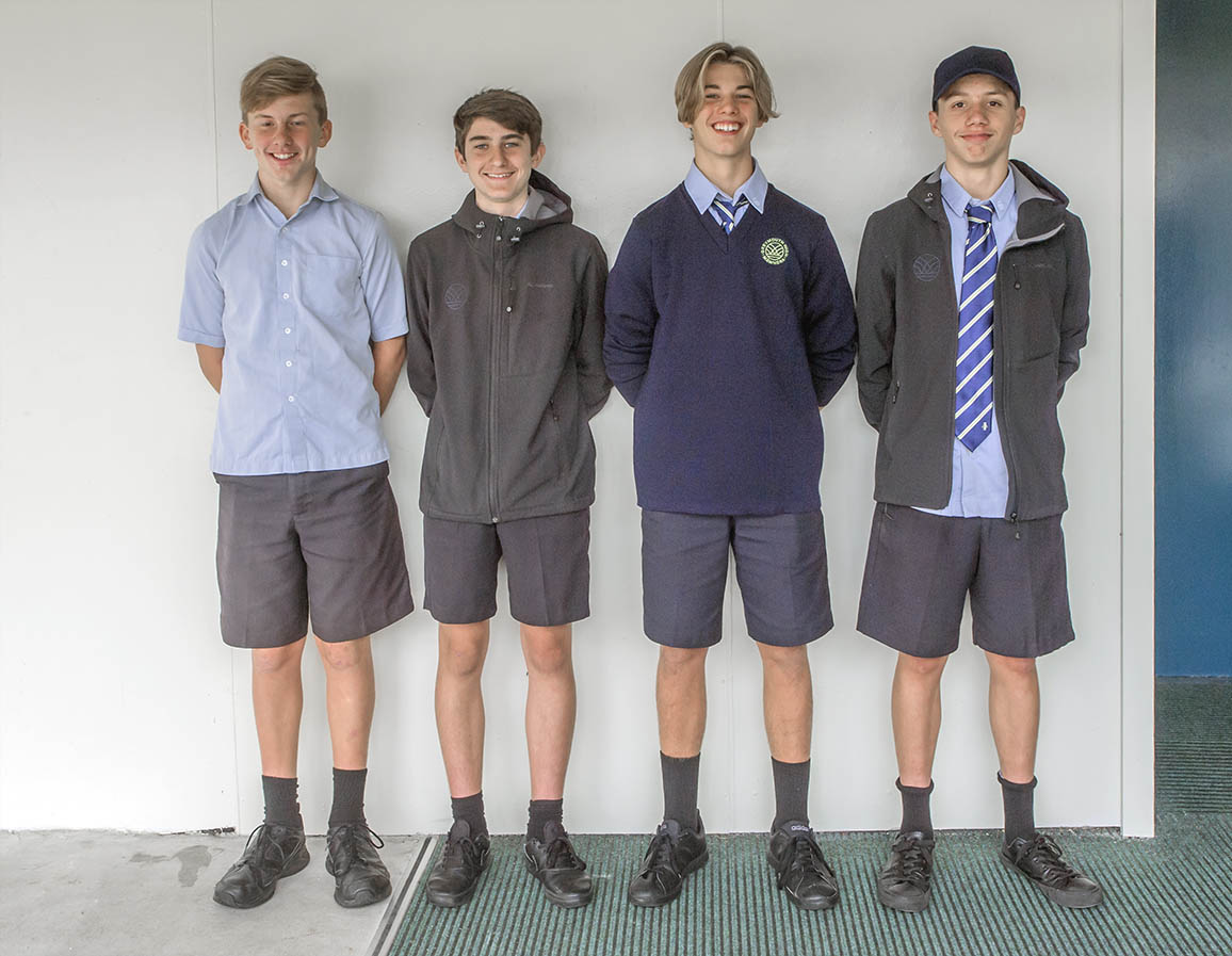 four male students wearing GHS uniform
